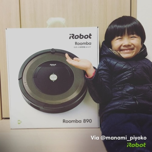 child with roomba box